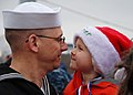 US Navy 111215-N-AW342-159 Electronics Technician 1st Class Joel Watson holds his son after returning from a five-month deployment aboard the Los A.jpg