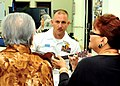 US Navy Lt. Cmdr. Mike Foskett plays the ukulele as local elderly women sing the Chamorro song during a community service project at the Yona-Talofofo Senior Citizens Center in Talofofo.jpg