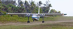 Unity Airlines Britten-Norman Islander taking off at Aneityum Airport.jpg