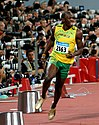 Jamaican athlete Usain Bolt slowing down after winning the 2008 Olympic Games 100 m final in a record-breaking time