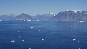 Niaqornat - Aerial view of the central expanse of Uummannaq Fjord, with Salleq Island, Appat Island, and Perlerfiup Nunaa in the background