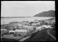View of Whakatane Harbour and buildings along the waterfront. ATLIB 291917.png