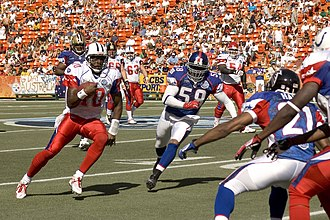 2007 Pro Bowl - AFC quarterback Vince Young scrambles past Antonio Pierce for a first down during the third quarter.