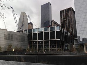 World Trade Center (2001–present) - The National September 11 Memorial & Museum. The memorial is in the foreground, the museum to the left.