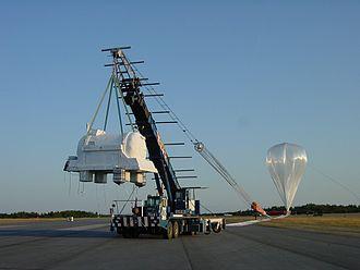 "Lynn Lake - NASA's ""Balloon-borne Experiment with a Superconducting Spectrometer"" lifting off near Lynn Lake, August 7, 2002"