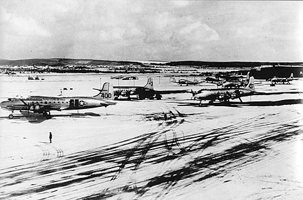 C-54s stand out against the snow at Wiesbaden Air Base during the Berlin Airlift in the Winter of 1948-49 Wiesbaden Air Base during Berlin Airlift 1949.jpg