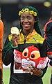 Women's 100 m podium Beijing 2015 cropped.jpg
