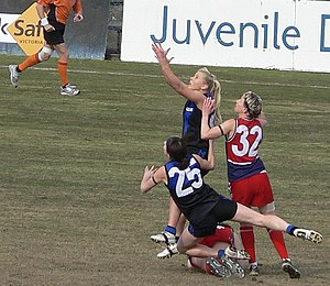 Victorian Women's Football League - Melbourne University player jostles for best position in a marking contest.