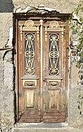 Wooden door of an old house.jpg