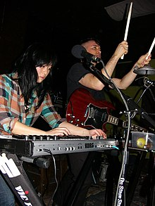 Angela Seo (left) and Jamie Stewart (right) performing with Xiu Xiu in 2010