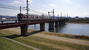 Domyoji Line - Kintetsu 6400 series train crossing the Yamato River on the Domyoji Line, February 2007