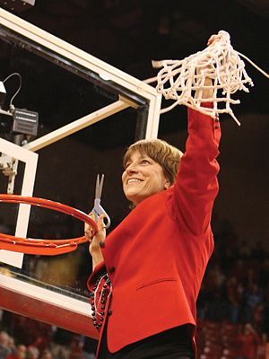 2009–10 Nebraska Cornhuskers women's basketball team - Connie Yori, cutting the nets after leading Nebraska to the 2010 Big 12 Conference regular-season title with a perfect 16-0 record