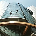 -skyscraps -Dhaka -worker (16854742451).jpg