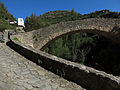 006 Pont del Rossinyol, cara sud, amb la roca Gironella al fons.JPG