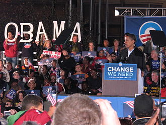 "2008 United States presidential election - Obama campaigning as a symbol of change in Cleveland, Ohio with a ""Change We Need"" sign"