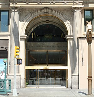 Toy Center - Building entrance on Fifth Avenue; the clock seen below is in profile on the right