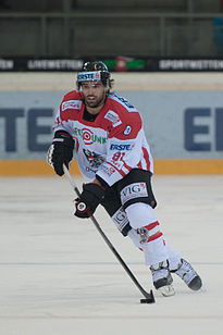 Ice hockey player with ice hockey stick
