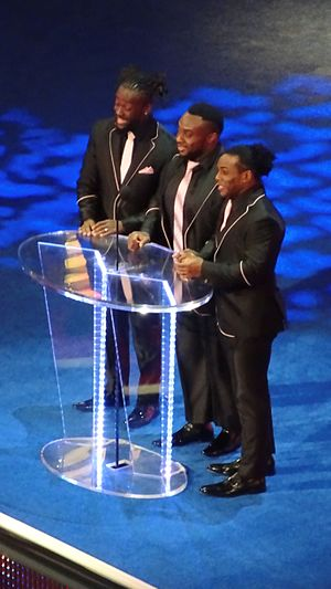 The New Day (wrestling) - Kingston, Big E and Woods inducting The Fabulous Freebirds into the WWE Hall of Fame in April 2016