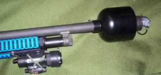 Rifle grenade - A riot control grenade in a launching cup attached to a Mossberg 500 riot shotgun