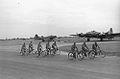 92d Bomb Group riding bikes past B-17s.jpg