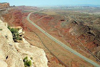 U.S. Route 191 - From Gold Bar Rim heading north from Moab - historical highway segment visible along far side of canyon