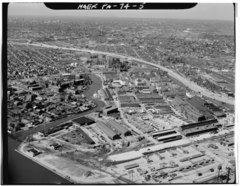 AERIAL VIEW LOOKING WEST. LAND IN FOREGROUND WAS AQUIRED IN 1917. - Frankford Arsenal, South of Tacony Street between Bridge Street and tracks of former Pennsylvania Railroad, HAER PA,51-PHILA,693-5.tif
