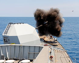 A 4.5 inch shell is captured in flight as Type 23 frigate HMS Northumberland conducts a gunnery exercise.jpg