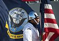 A Sailor participates in a change of command. (15698019149).jpg