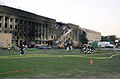 A view of the damage done to the Western ring of the Pentagon Building as firefighters conduct rescue operation, hours after American Airlines Fight 77 was piloted by terrorists into the building, during the 010911-N-AV833-011.jpg
