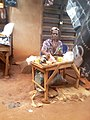 African people at work - A shoe cobbler.jpg