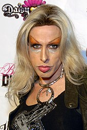 Alexis Arquette looking to the camera, in heavy eye makeup.