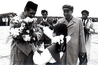 Ali Sastroamidjojo - Ali Sastroamidjojo is greeted by Zhou Enlai upon his arrival in Beijing, 26 May 1955.