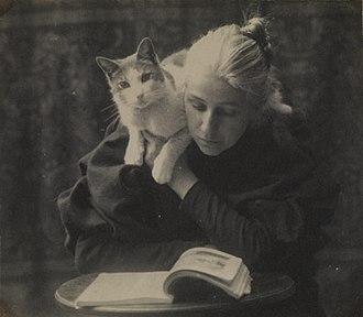 Miss Amelia Van Buren - Attributed to Thomas Eakins, a photograph of Amelia C. Van Buren with a cat, c. late 1880s–1891