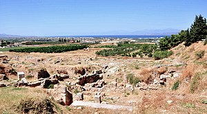 Ancient Corinth - Archeological site of Ancient Theater first built in Corinth in 5th c. BC. The Theater could seat around 15000 spectators.