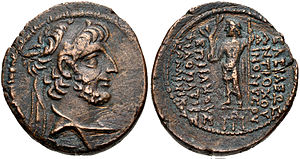 A coin of king Antiochus XII. On its reverse, the Greek god Zeus is depicted, while the obverse have the king's bust