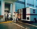 Apollo 16 crew walk to transfer van (KSC-72PC-253).jpg