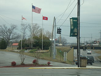 Ardmore, Tennessee - Ardmore Veterans Memorial, with the U.S. flag and state flags of Alabama and Tennessee