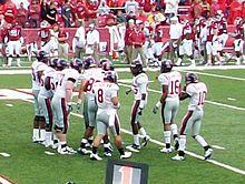 Jeremiah Masoli Enters The Ole Miss Huddle During Arkansas Game See Also 2010 Razorbacks Football Team