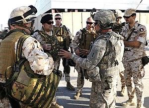 NATO Training Mission – Iraq - Italian Major General Giovanni Armentani, Deputy Commanding General for the NATO Training Mission, meets with a U.S. Advise and Assist Brigade.