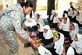 Army Sgt. Grace Altaya distributes school supplies to Baktash Secondary School (6216596577).jpg