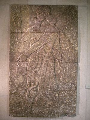 Winged genie - Image: Assyrian winged genie from Nimrud
