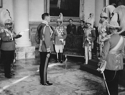 King Tribhuvan giving an audience to British general Claude Auchinleck at the royal palace in Kathmandu, 1945 AuchinleckNepal.jpg