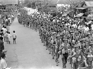 2/31st Battalion (Australia) - Soldiers of 2/31st Battalion passing through Bandjermasin on 17 September 1945 to an enthusiastic welcome from local civilians