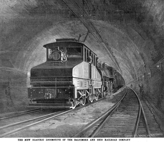 EL-1 Electric locomotive of the Baltimore Belt Line, US 1895: The steam locomotive was not detached for passage through the tunnel. The overhead conductor was a [?] section bar at the highest point in the roof, so a flexible, flat pantograph was used B&O 1895 loco.png