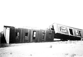 1916 Gulf Coast hurricane - Camp train cars for a lumber company overturned by the hurricane in Bagdad, Florida