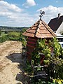 Barrel, tiled roof and the rooster in Egregy, 2016 Hungary.jpg