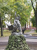 Belarus-Minsk-Boy Playing with Swan Sculpture-1.jpg
