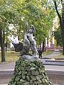 Belarus-Minsk-Boy Playing with Swan Sculpture-1.jpg