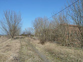 Anhalt Suburban Line - Embankment of the suburban railway to the west of the station building of Großbeeren station.