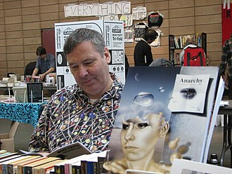 Bob Black - Bob Black seated at the Anarchy: A Journal of Desire Armed booth, attending the 2011 Bay Area Anarchist Bookfair